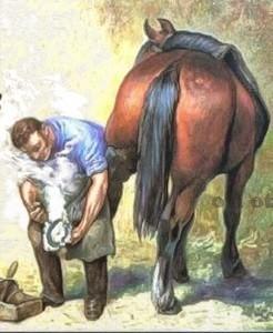 Налбант подковава кон.